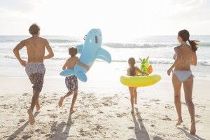 Family-playing-together-on-beach